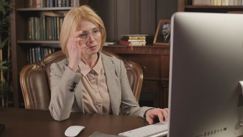 Female Lawyer Using a Computer then Looking at Camera