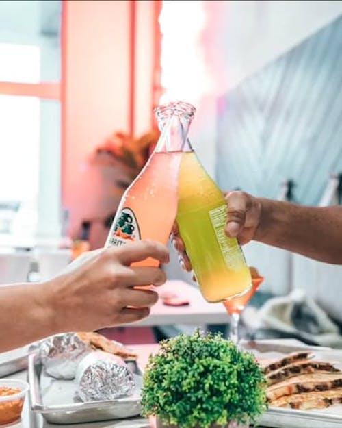 Boomerang Video of People Clinking Bottles