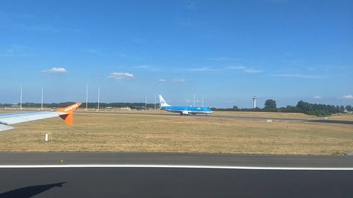 An Airplane Taking Off A Runway