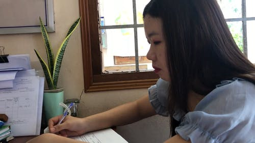 Woman Writing on the Paper