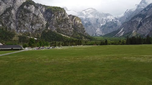 Drone Landing On The Grass Field Of A Mountain Resort