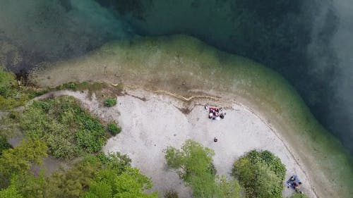 Drone Footage of Family Having a Picnic on Shore
