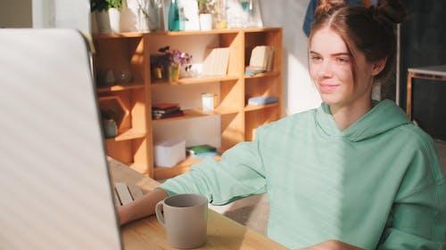A Girl Communicating Through Video Call