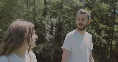 Couple Talking While Walking