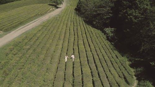 Couple Walking on the Field