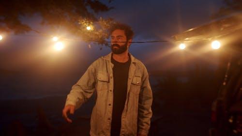 Man Holding the Hanged Lights