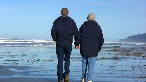 Couple Walking While Holding Hands