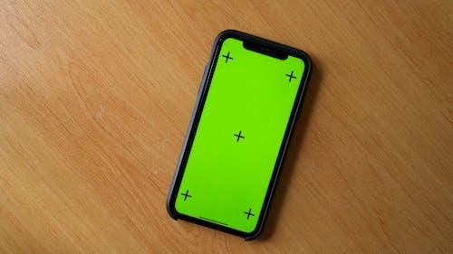 Mobile Phone on Wooden Desk