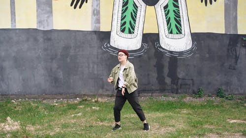 A Girl Dancing In A Vacant Lot