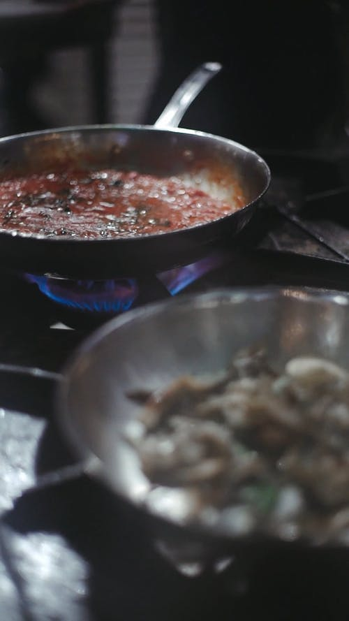 Two Dishes In A Frying Pan Being Cooked