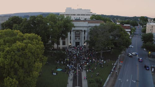 Protesters Gathered in front of a Building