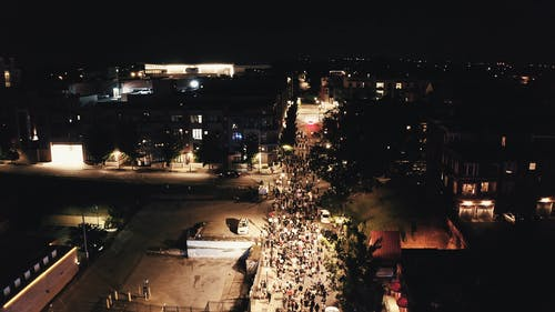Aerial View of Protesters Walking on a Street