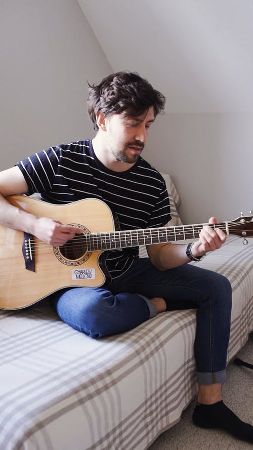 Person Playing The Guitar