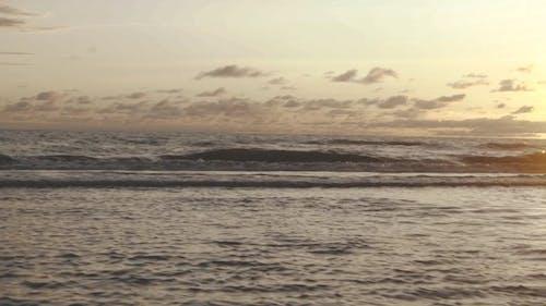 Waves Breaking By The Seashore