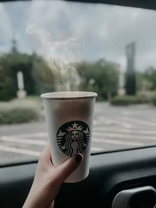 A Person Holding a Coffee Cup
