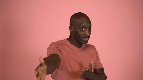 A Man Using Hand Gestures For Communication