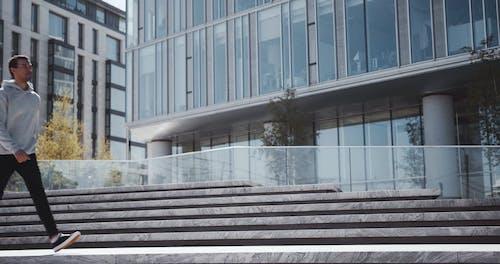 Man Walking Down A Concrete Stairs