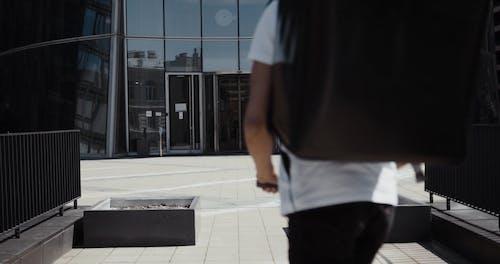 A Food Deliveryman Entering A Building
