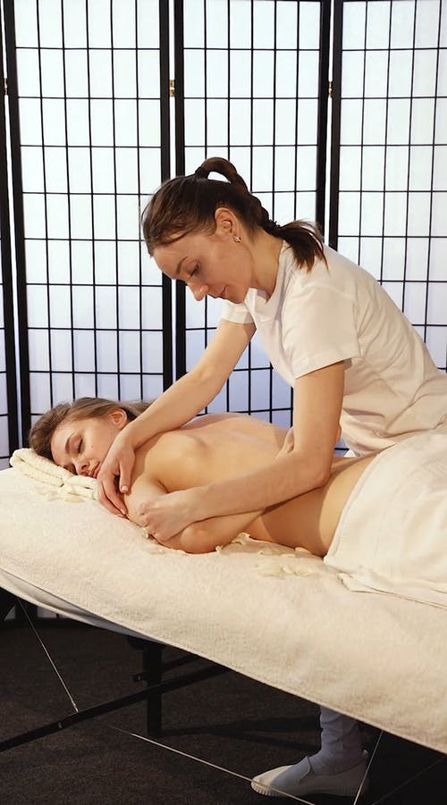 Woman Performing A Body Massage