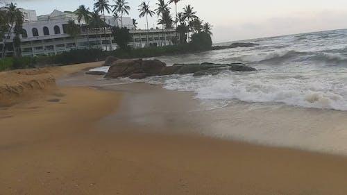 Waves Crashing On Rocks By The Seashore
