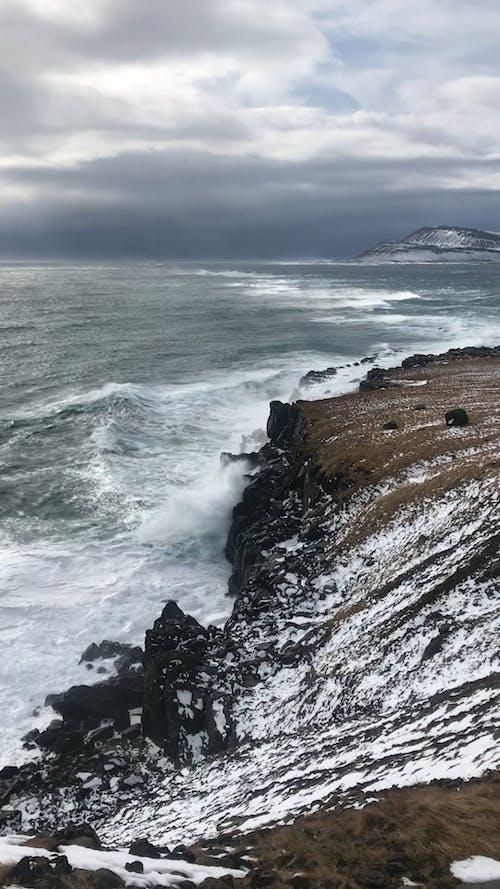 Waves Crashing On A Rocky Mountain