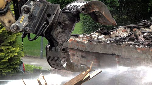 Demolition Of A Building Using A Heavy Equipment