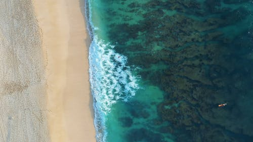 High Angle View Of Waves Rushing To Shore