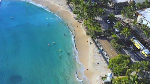 Drone Footage Of A Beach Near City Buildings