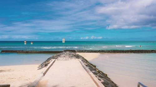 Seascape Under Blue Cloudy Sky