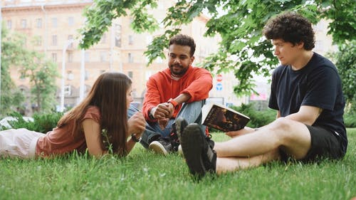 Three People Having Conversation About The Book