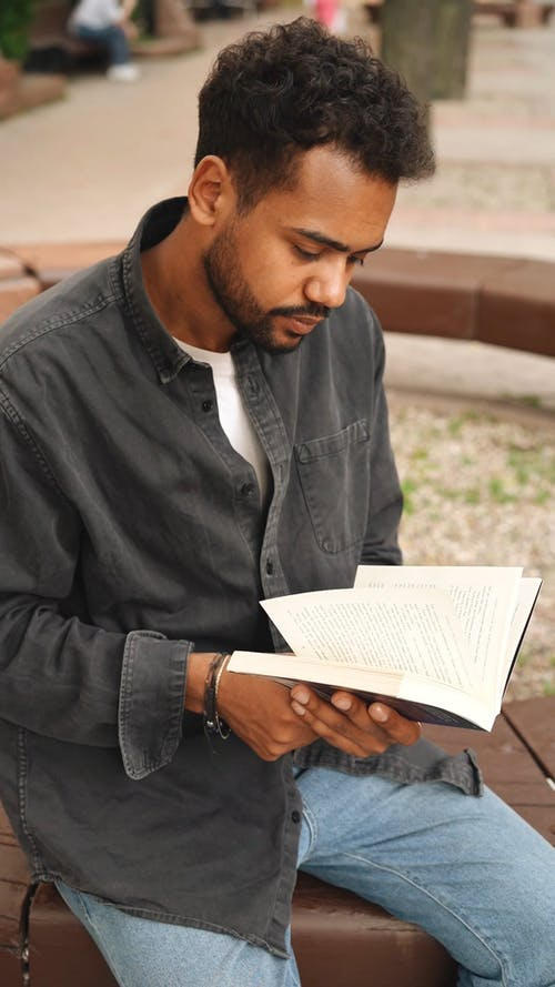 Video Of Man Reading Book