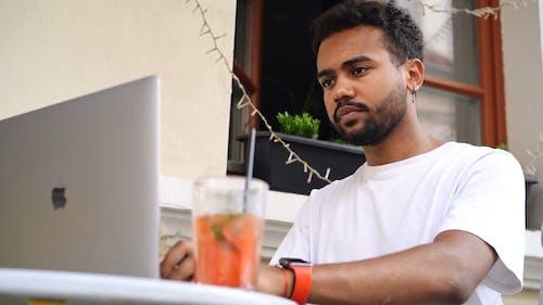 Close-Up Video Of Man Using Laptop
