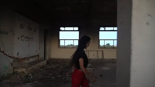 Video Of Woman Running On An Abandoned Building