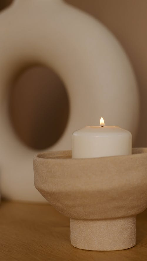Lighted Candle In A Ceramic Candle Holder