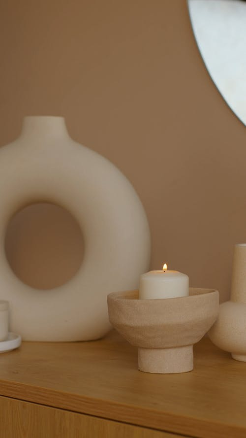 Lighted Candle On Ceramic Candle Holder