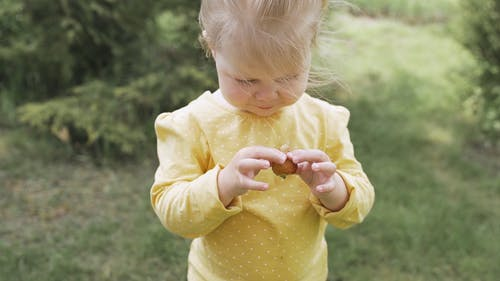 Video Of Child Holding Strawberry