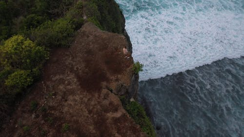 Video Of Man Standing On Cliff Edge