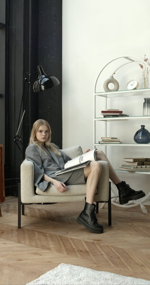 Video Of Woman Sitting On Sofa Chair