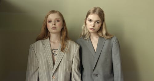 Two Female model Wearing Suits