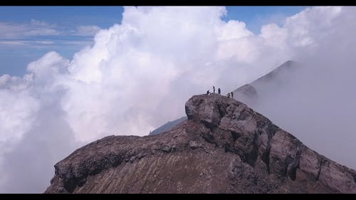 People On Top Of A Rocky Mountain