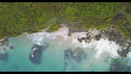 Bird's Eye View Of Waves Crashing Seashore
