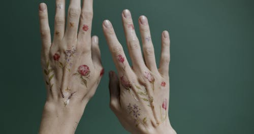 Temporary Tattoo On A Person's Hands