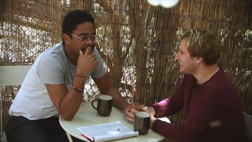 Video Of Men Talking Over Coffee
