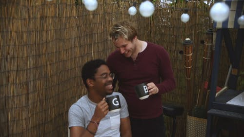 Video Of Men Holding Cup Of Coffee