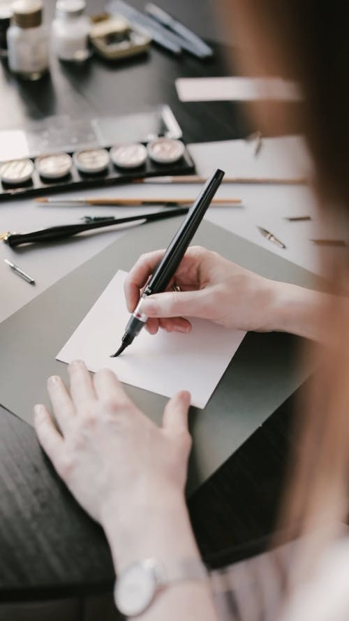 Person Using Brush Pen
