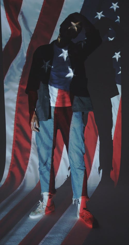 Man in Front of a Projection of the American Flag