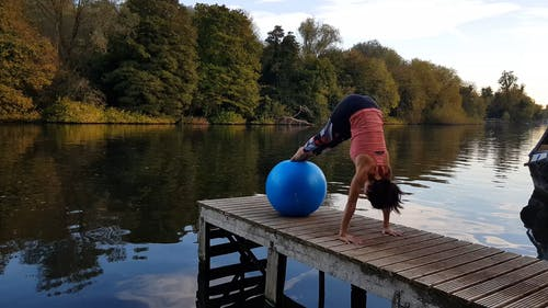 Woman Doing Stretching Exercise With A Yoga Ball