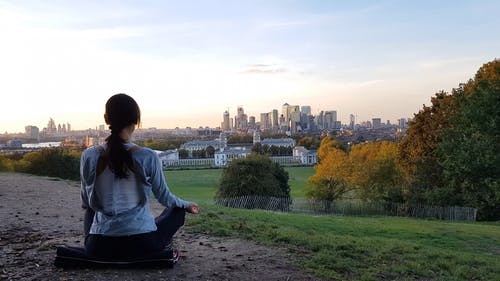Woman Meditate in the City View