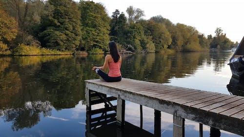 Woman Meditate on the Lake