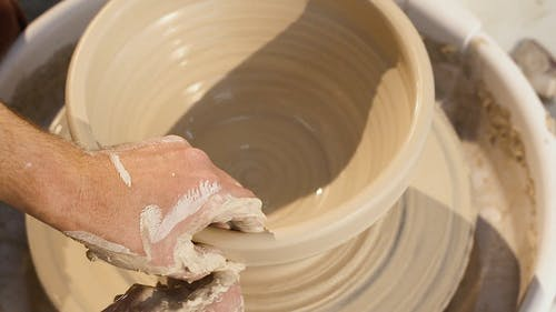 Close-Up Video Of Man Molding Clay Pot